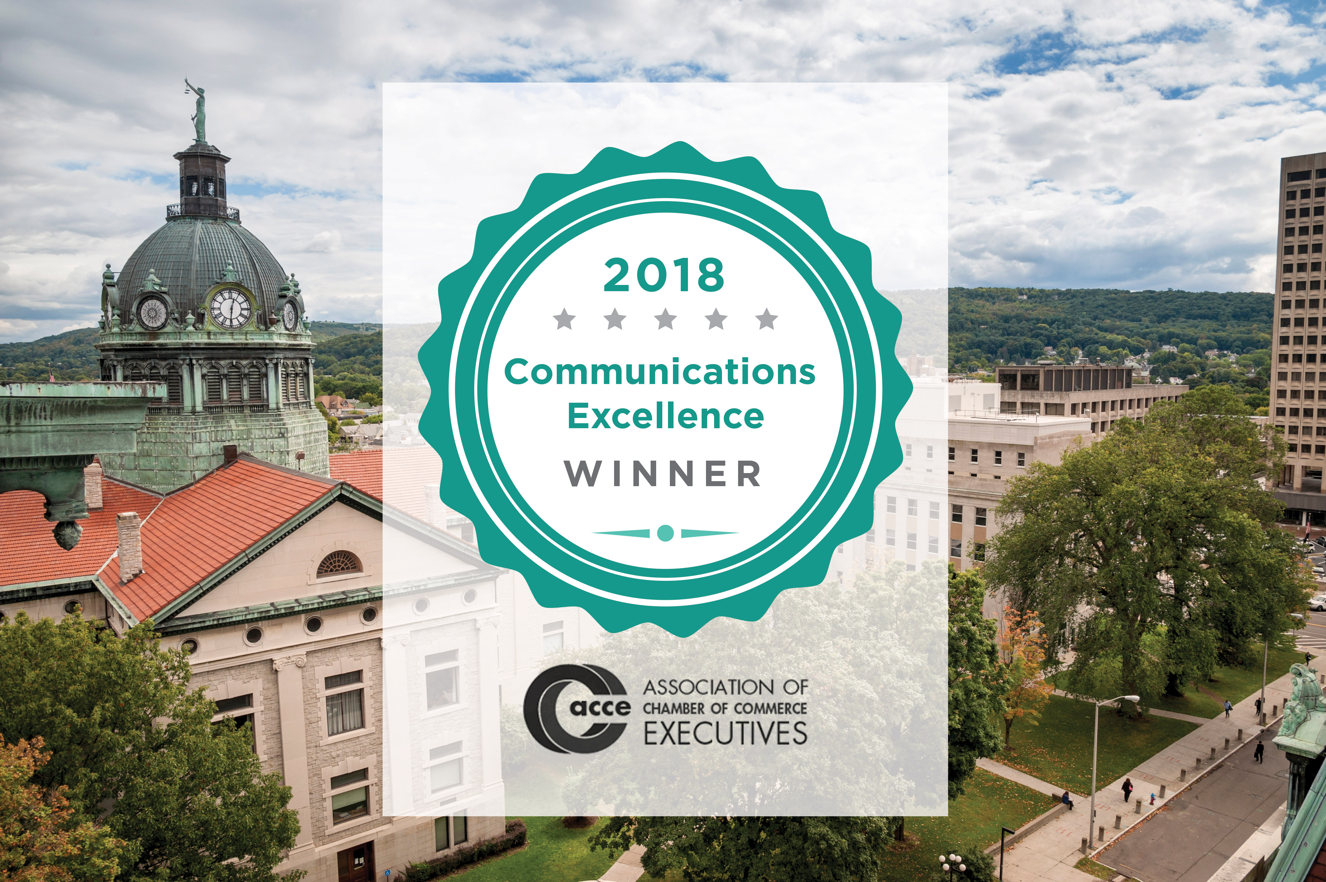 2018 Communications Excellence Winner award from the Association of Chamber of Commerce Executives for the Greater Binghamton Chamber of Commerce branding project placed on a photo of downtown Binghamton, NY courthouse