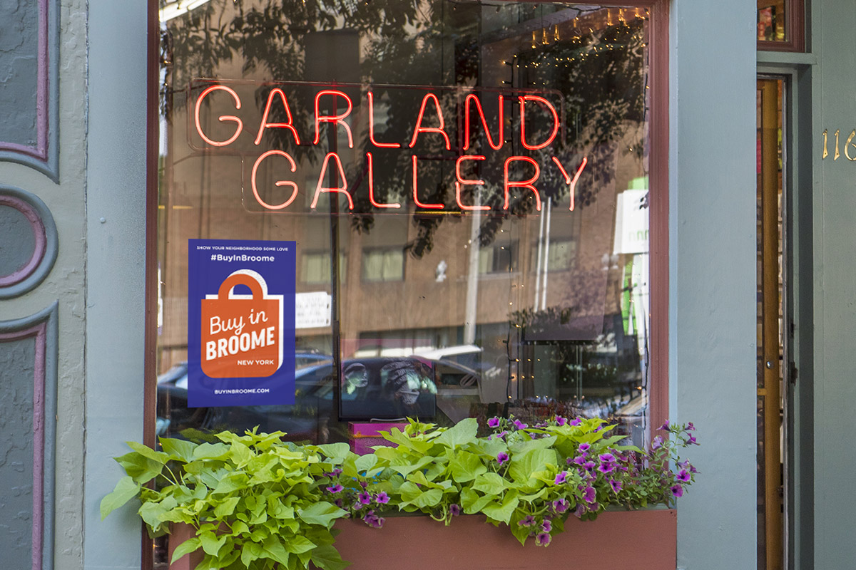 Garland Gallery window with Buy in Broome poster